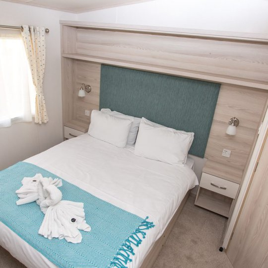 Comfortable double bed with pillows & linen included